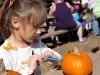 Sarah decorating her pumpkin