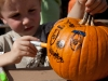 Cole decorating his pumpkin